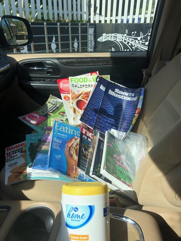 Judy drop off - car full of magazines and wetwipes